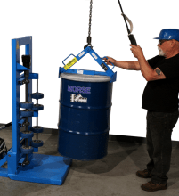 Load drum onto drum rotator with Hoist Attachment
