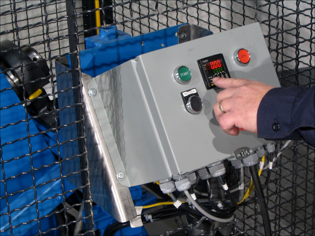 Setting the timer for 311 Series Automated Tilt-to-Load Drum Tumbler
